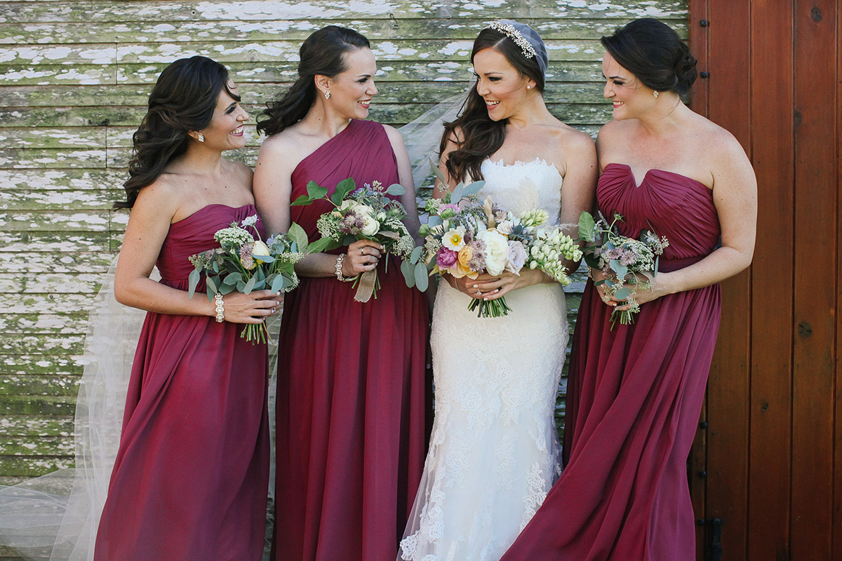 bridesmaids in flowy marsala gowns / flowers by Ever After Floral Design / photo by angelawinsorphotography.com